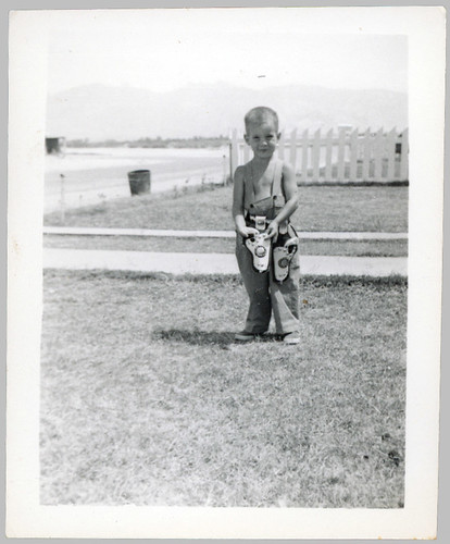 Boy with two holsters