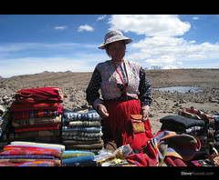Dream World (Steve Rosset) Tags: world travel woman mountains peru southamerica colors geotagged clothing high outdoor plateau vibrant exploring traditional dream may tagged exotic blankets elevation geo selling 2009 distant steverosset steverossetphotography