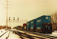 Northbound intermodal train passing through La Grange Park Illinois over the Indiana Harbor Belt Railroad. January 1987.