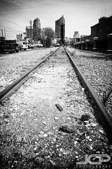 Vanishing Point Tampa Train Tracks (Jason Collin) Tags: skyscraper tampa vanishingpoint blackwhite holga traintracks f11 nikond300 tamronaf1750mmf28xrdiii silverefexpro