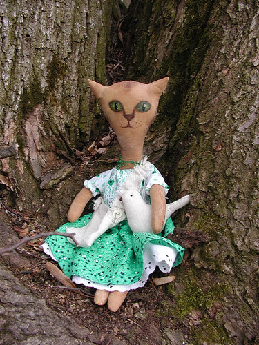 kitty in green dress