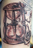 cracked hourglass Tattooed by Johnny