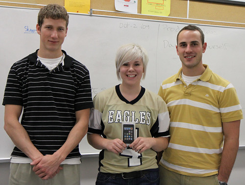 Mike McCaffery (l) and Mike Greaves (r) present Krista Bannon with an iPod Touch for 1st place in the Business Plan Competition.