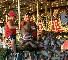 Merrygoround Happy (cobalt123) Tags: arizona phoenix smile canon20d roundabout carousel fair merrygoround carnivalride wideanglelens amusementride arizonastatefair 17mm40mm