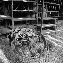 iron wheels and shelving (Uncle Frodus) Tags: november ohio abandoned square midwest farm wheels panasonic squareformat hay shelves 2009 43 treefarm panny fourthirds farmimplement ironwheels knoxcounty dmcl1 lumixdmcl1