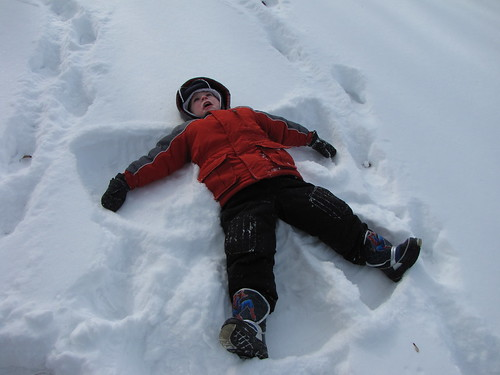 Snow Fort Fun - Benjamin making a snow angel