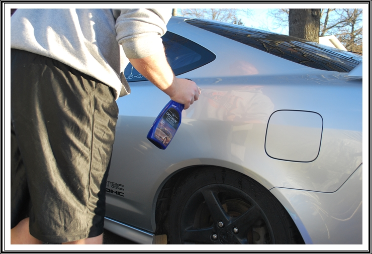 Spraying Optimum Car Wax on Acura RSX