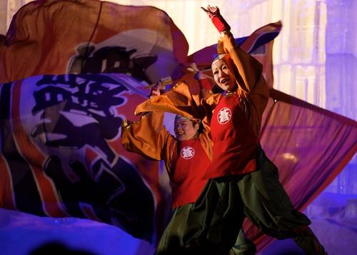 Yosakoi Dancers performing behind a massive Ice sculpture