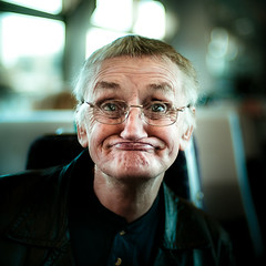 Man on Train (TGKW) Tags: old portrait people man silly public face train glasses funny sitting expression glasgow transport elderly wrinkles gurning 7390 spectables