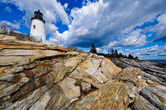 Pemaquid Point Lighthouse - Bristol, Maine (briburt) Tags: ocean blue sky lighthouse water rock clouds bristol coast nikon rocks angle maine newengland dramatic rocky wideangle icon atlantic diagonal coastal shore granite dramaticsky atlanticocean pemaquid striated pemaquidpoint d90 sigma1020 pemaquidpointlighthouse bristolmaine nikond90 flickrgolfclub briburt