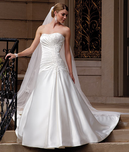 Wedding gown with a headdress and a long tail