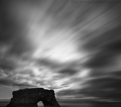 The Path of Least Resistance - Santa Cruz, California (Jim Patterson Photography) Tags: ocean california statepark longexposure sea wild sky blackandwhite usa santacruz seascape storm art beach nature water clouds landscape photography bay coast marine rocks arch natural pacific artistic cove wildlife seagull tripod shoreline rocky wideangle stormy pelican coastal shore lee coastline gitzo naturalbridges reallyrightstuff statebeach remoterelease nikkor1224mm graduatedneutraldensityfilter bwpolarizer mbnms nikond300 markinsm20ballhead jimpattersonphotography jimpattersonphotographycom montereybaynationalmarinesancturay bw10stopneutraldensityfilter seatosummitworkshops seatosummitworkshopscom
