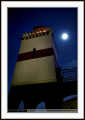 Lighthouse (Clayton Perry Photoworks) Tags: city winter sky moon lighthouse canada night vancouver reflections lights december bc britishcolumbia stanleypark claytonperry