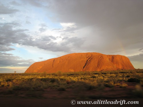 Sun peaking oout on Uluru