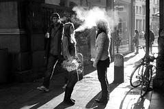 Smoking in the light (Donato Buccella / sibemolle) Tags: street boy blackandwhite bw italy milan girl backlight streetphotography smoking piazzamercanti canon400d sibemolle jeuxdelumireetdefume fotografiastradale intercitycontestgennaio2012milano