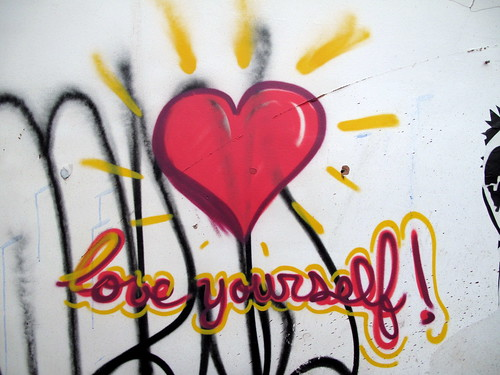 "graffiti: big red heart with the words ""love yourself!"" in cursive, written underneath"