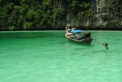 Lone boat on a beautiful sea (dumbskull) Tags: deleteme5 sea deleteme8 color deleteme deleteme2 deleteme3 deleteme4 green deleteme6 deleteme9 deleteme7 beach water topv111 wow thailand topv333 saveme deleteme10 phuket rateme17