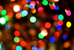 Bokeh Swirl (tumultuouswoman) Tags: christmas carnival pink blue red orange white blur beautiful yellow fun happy lights purple bright bokeh circles round joyful discs