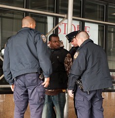 NYPD picks up a Guest (Diacritical) Tags: newyorkcity snow brooklyn scaffolding police nypd sidewalk law lawenforcement handcuffs arrest 70mm detained 2470mmf28 d700