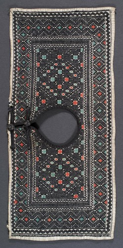 //Baby Collar,// Dong people. China, Yunnan province, 20th century, 39 x 17 cm. From the collection of Tan Tim Qing, Kunming. Photograph by D Dunlop.