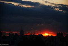 Clouds, sun, buildings