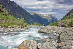 Rauma River (BangsUndeveloped) Tags: travel vacation sky holiday mountains nature water norway clouds river landscape norge sightseeing tourist norwegian fjord rauma trollstigen andalsnes mreogromsdal ndalsnes canonxsi stigfossenwaterfall thetrollladder nationalroad63