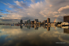 Sometimes A Rainbow Comes Before The Rain (Primum Non Nocere) Tags: sky reflection bay rainbow cityscape yacht philippines manila manilabay baywalk ccp philippine ncr roxasboulevard harborsquare culturalcenterofthephilippines pasaycity harboursquare manilayachtclub nationalcapitalregion perfectescapes philippinenavyheadquarters