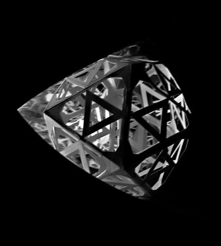 Facets. Hand cut card polygonal model  Ⓒ Sara Choudhrey