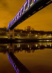 Only After The Last Train Of The Night Does The City Seem Deserted (Humber Bridge Boy) Tags: uk bridge blue light yellow night train river newcastle lights long exposure metro low structure tyne february northeast starburst towerblock alexhay canon40d