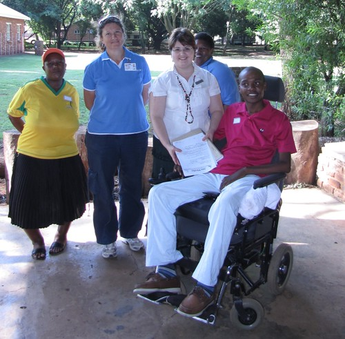 Chrisna Goddefry of Rob Ferreira Hospital handing over a list of 60+ new Ama Wheelies members