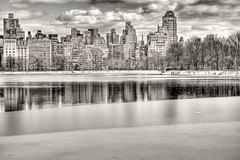 the upper east-side cityscape, ny (mudpig) Tags: nyc newyorkcity winter sky bw cloud white lake snow newyork black reflection ice skyline landscape geotagged cityscape view centralpark monotone reservoir hdr jacquelinekennedyonassisreservoir mudpig stevekelley