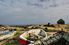 Three boats and a Hut (*Debi) Tags: old beach northumberland hut fishingboats hdr picnik beadnell abandonedboats dynamicphotohdr