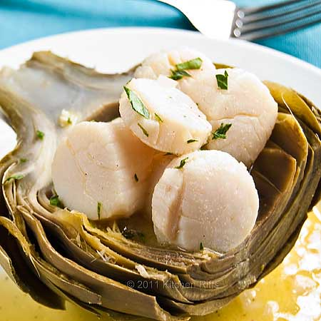 Poached Scallops in an artichoke scoop on plate with mustard vinaigrette