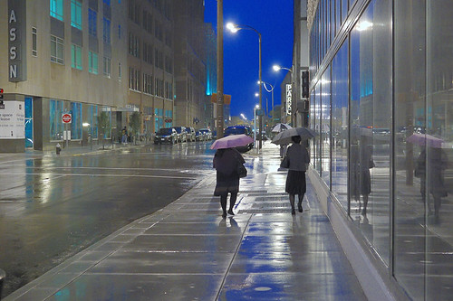 Downtown Saint Louis, Missouri, USA - pedestrians at dusk in the rain