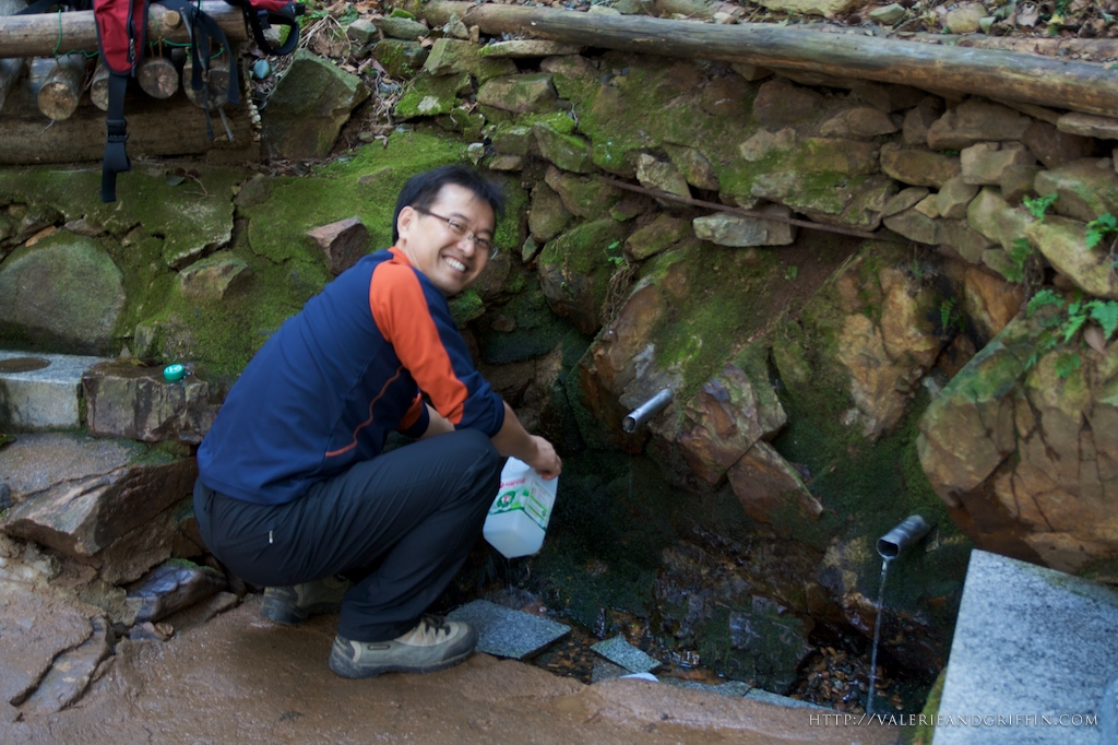 Mr. Choi getting water from the spring at the top of the mountain.