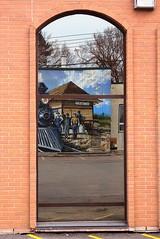 Red Brick & Mural in the Window (Stella Blu) Tags: stella red canada reflection brick window canon mural blu alberta parkland stonyplain challengeyouwinner a640 achallengeforyou thechallengefactory herowinner pregamewinner