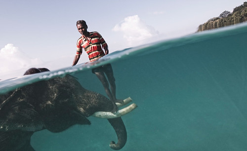 Nazroo, a mahout (elephant driver), poses for a portrait while taking his elephant, Rajan, out for a swim in front of Radha Nagar Beach in Havelock, Andaman Islands. Rajan is one of the few elephants in Havelock that can swim, so when he is not dragging timber in the forest he is used as a tourist attraction. The relationship between the mahout and his elephant usually lasts for their entire lives, creating an extremely strong tie between the animal and the human being. (Photo and caption by Cesare Naldi)