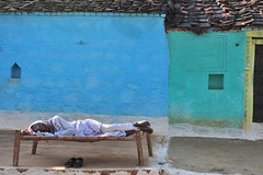 Sleeping in Orchha (Robert H Chapman) Tags: blue roof sleeping india house man color colour green yellow shoes colorful sleep colourful orchha