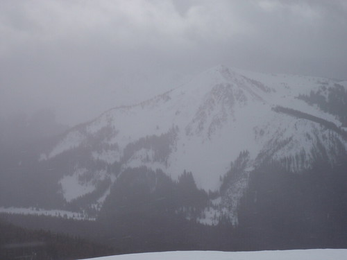 An un-named peak appears out of the clouds in the Silver Cr. Drainage.