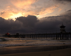 sunshine behind the clouds (jst images) Tags: california ca seascape reflection beach silhouette clouds pier orangecounty oc huntingtonbeach hb stormclouds feelsgood wetreflection hbpier huntingtonpier justimages thisfeelsgood jasontockey jstimages