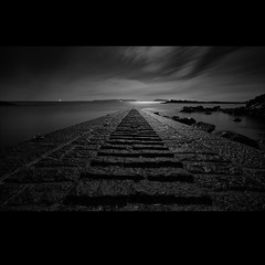 there is a light /\t the end of the road (s k o o v) Tags: longexposure bw pyramid bordeaux fullmoon guernsey slipway sigma1020
