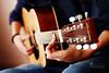 Tempo... (SonOfJordan) Tags: musician music playing color film canon eos warm guitar grain amman jordan strings tempo guitarist chord xsi 450d samawi sonofjordan wwwshadisamawicom