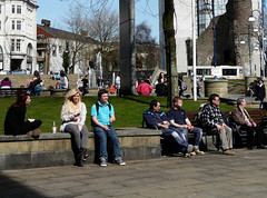 In the square (Andy WXx2009) Tags: girls people urban woman sexy men wall swansea wales architecture bench europe sitting candid femme streetphotography jeans blonde mobilephone crosslegged