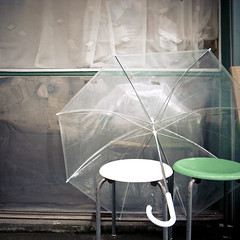 Clear Vinyl Umbrella Just Waiting in the Rain (jacob schere [in the 03 strategically planning]) Tags: white reflection green window japan umbrella square tokyo see chair waiting empty jacob vinyl communication plastic chiba wait through stool stools lucid narashino schere grii waitingintherain jacobschere lucidcommunication