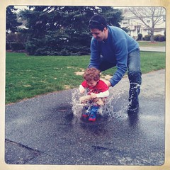 Playing in the rain (Christine Myaskovsky (chrissymckeen)) Tags: family baby playing storm abstract cute rain weather fun outside happy back kid jump jumping funny alone child play boots flood uncle nephew laugh app iphone rainboots emoitions