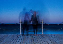 waiting to kiss (PDKImages) Tags: shadows ghosts love kiss beauty not there story looking memories waiting searching disappeared disappearing firstkiss lastkiss silhouettes hooded wishing monochrome sea coast waves blues blue lost palomarenaissance sky turkey