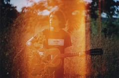 Myself's Burning (Ludovic Macioszczyk Photography) Tags: myselfs burning canon ae1 135 fuji 400 iso leak leaks sweet ludovic shine light country plant hair summer love sweetheart ludo boy 1600 france macioszczyk analog photography film pellicule no flash fd 50mm 18 vintage camera photo photographie argentique keep alive ludos photographs dof 2009 35mm natural spring life shoot art people limousin holidays vacances crozant colors color portrait landscape nature sunny sun picture world photographe guitar music orange exposure négatif développement scan © tag