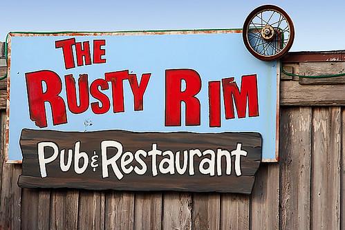 The Rusty Rim Pub  Restaurant Sign
