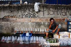 Let me capture your smile :) (anjur) Tags: street portrait people fish canon aquarium jakarta seller 500d