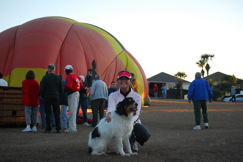 Amanda and Maverick in front of a hot air balloon